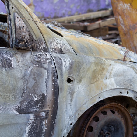An abandoned burnt down car photo