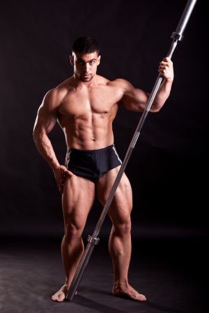 young bodybuilder posing in studio photo
