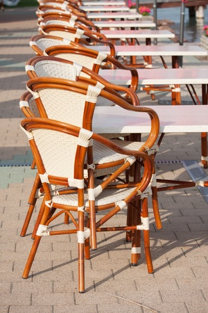 Beach cafe with wooden tables and chairs photo
