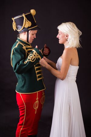 cavalryman: beautiful bride and hussar posing in studio