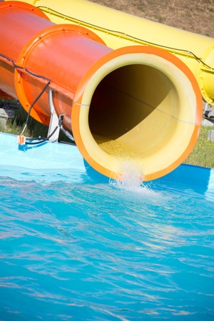 blue plastic waterslide in pool photo