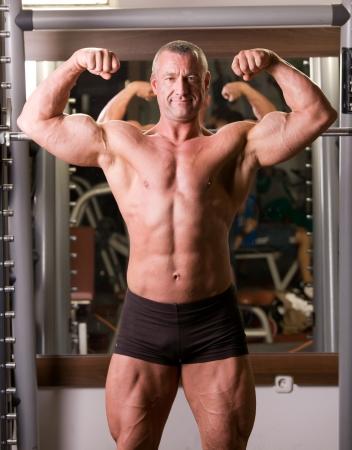 bodybuilder posing in a gym photo