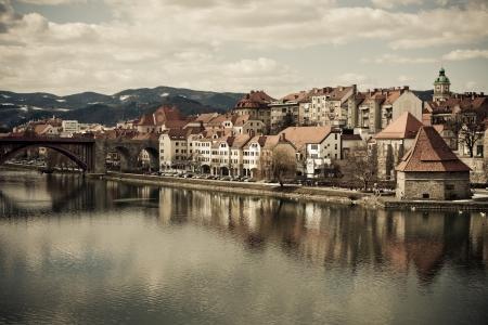 drava: Maribor in Slovenia with river Drava -colorized photo for old mood