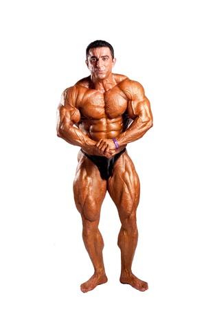 bodybuilder flexing his muscles in studio Stock Photo