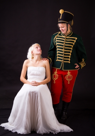 beautiful bride and hussar posing in studio photo