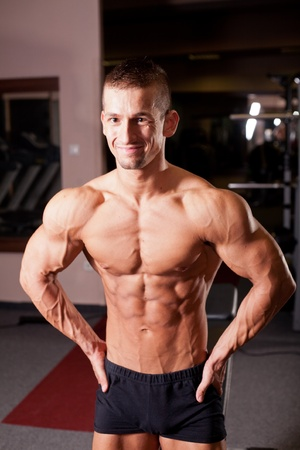 body builder: bodybuilder flexing his muscles in gym