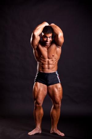 body builder: young bodybuilder posing in studio