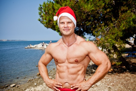 muscular santa claus in summer holiday photo