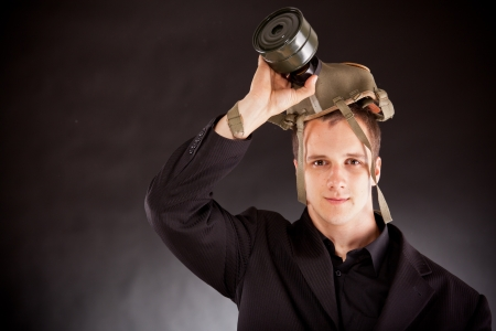businessman shouting through megaphone in studio photo