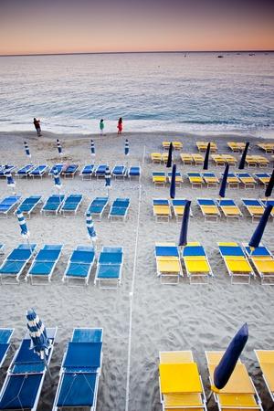 monterosso: beach umbrellas in a resort of Monterosso Editorial
