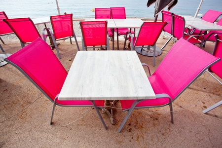 Beach cafe with table and chairs in Menton photo