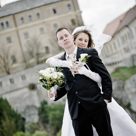 young beautiful wedding couple outdoor -colorized photo for old mood photo