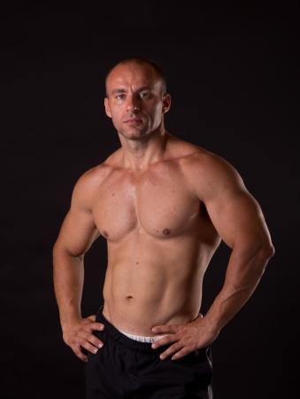 huge: young bodybuilder posing in studio