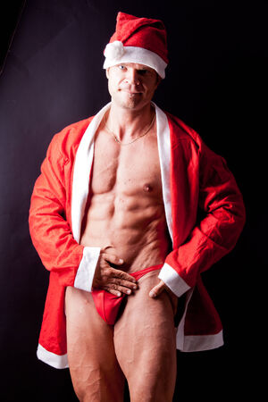 muscular santa claus posing in studio photo