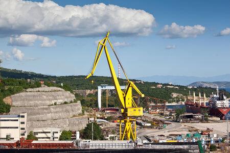 Big yellow crane in harbor Stock Photo - 24411275
