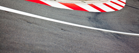 Car race asphalt and curb on Monaco Montecarlo Grand Prix street circuit photo