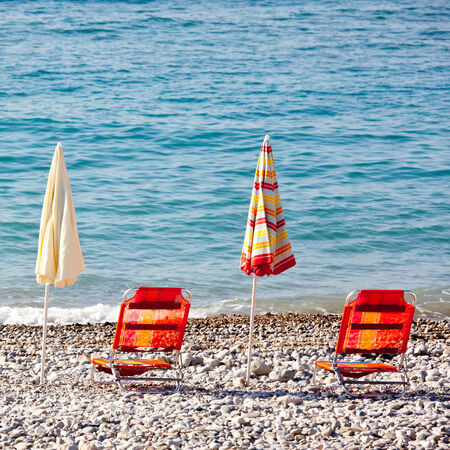beach umbrellas in a beach resort of Menton photo