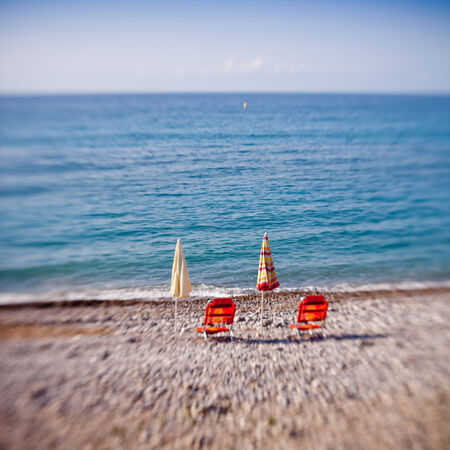 beach umbrellas in a beach resort of Menton -taken with lensbaby photo