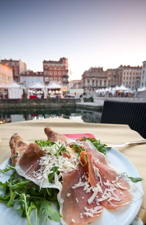 Ham with ruccola in Trieste photo