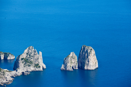 Capri blue sea with Faraglioni photo