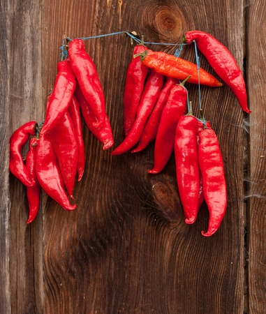 Red Chili Peppers hanging outdoor photo