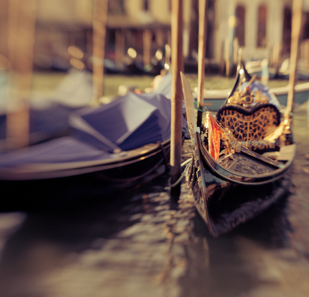 Gondolas in Venice, created with lensbaby for selective focus, colorized photo photo
