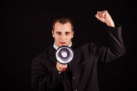 handsome businessman screaming in megaphone photo