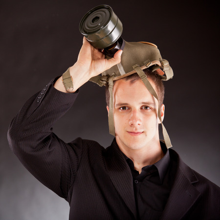 businessman shouting through megaphone in studio photo