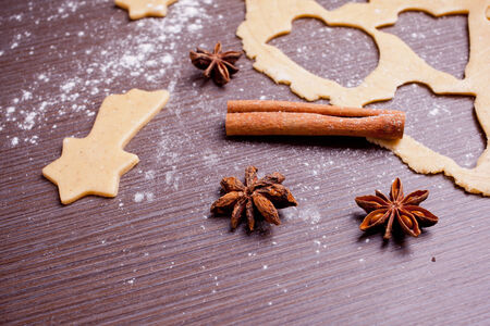 Christmas baking, cake form and spices photo