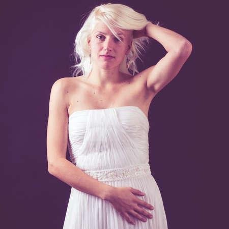 beautiful bride posing in studio photo