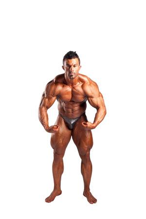pectorals: bodybuilder flexing his muscles in studio Stock Photo