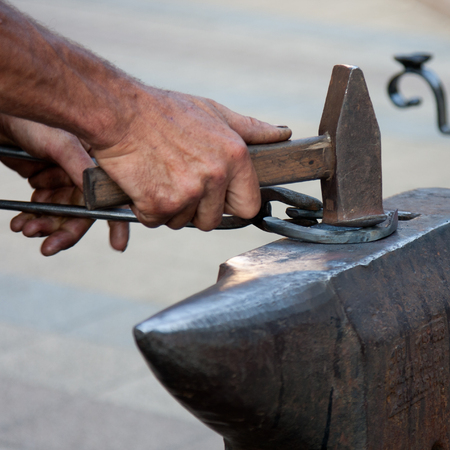 anvil: blacksmith working on anvil with hammer