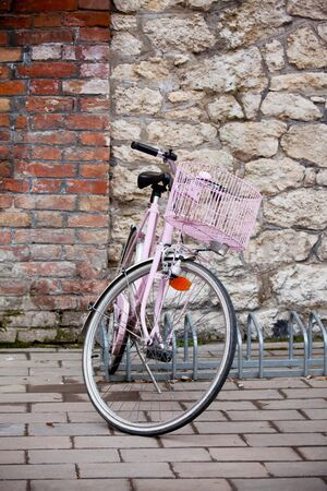 Old bicycle leaning against grungy wall photo