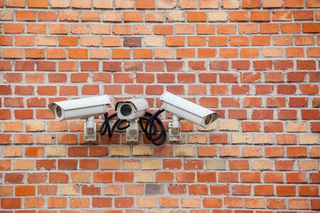 cctv camera: Security CCTV camera mounted on the building wall Stock Photo