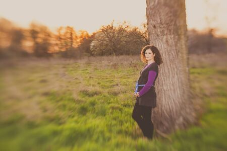 beautiful pregnant young woman outdoor taken by lensbaby for selective focus Stock Photo