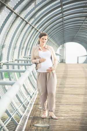 tunel: beautiful pregnant woman in a tunel