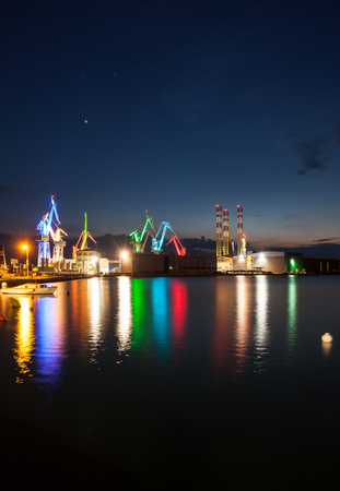 shipbuilder: Illuminated cranes at shipyard in Pula, Croatia