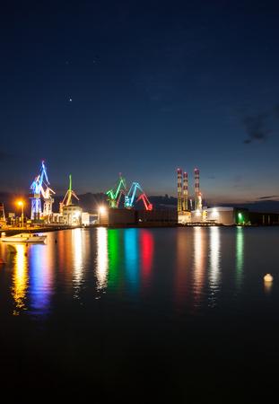 shipyard: Illuminated cranes at shipyard in Pula, Croatia