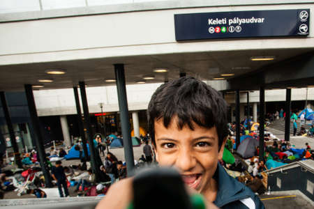 poorness: BUDAPEST - SEPTEMBER 4 : War refugees at the Keleti Railway Station on 4 September 2015 in Budapest, Hungary. Refugees are arriving constantly to Hungary on the way to Germany. Editorial