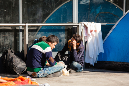 assad: BUDAPEST - SEPTEMBER 7: war refugees waiting at Keleti Railway Station on 7 September 2015 in Budapest, Hungary. Refugees are arriving constantly to Hungary on the way to Germany.