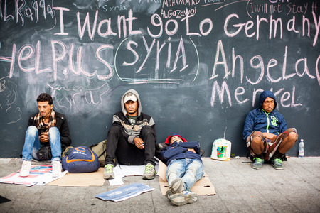 war refugee: BUDAPEST - SEPTEMBER 4 : War refugees at the Keleti Railway Station on 4 September 2015 in Budapest, Hungary. Refugees are arriving constantly to Hungary on the way to Germany. Editorial