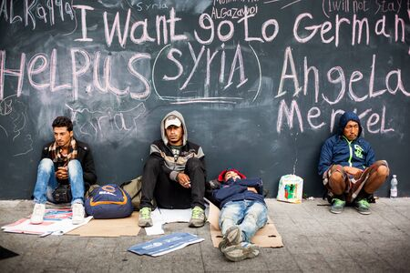 middle east crisis: BUDAPEST - SEPTEMBER 4 : War refugees at the Keleti Railway Station on 4 September 2015 in Budapest, Hungary. Refugees are arriving constantly to Hungary on the way to Germany. Editorial