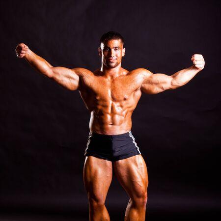 pectorals: young bodybuilder posing in studio