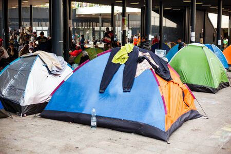 assad: BUDAPEST - SEPTEMBER 4 : War refugees camp at the Keleti Railway Station on 4 September 2015 in Budapest, Hungary. Refugees are arriving constantly to Hungary on the way to Germany.