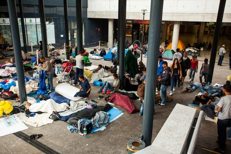 poorness: BUDAPEST - SEPTEMBER 4 : War refugees camp at the Keleti Railway Station on 4 September 2015 in Budapest, Hungary. Refugees are arriving constantly to Hungary on the way to Germany.