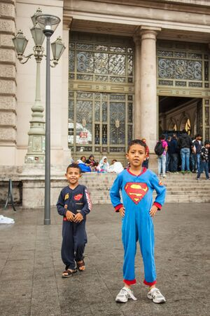 assad: BUDAPEST - SEPTEMBER 4 : War refugees children dressed superman at the Keleti Railway Station on 4 September 2015 in Budapest, Hungary. Refugees are arriving constantly to Hungary on the way to Germany. Editorial