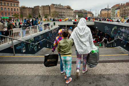 BUDAPEST - SEPTEMBER 4 : War refugees at the Keleti Railway Station on 4 September 2015 in Budapest, Hungary. Refugees are arriving constantly to Hungary on the way to Germany. Editorial
