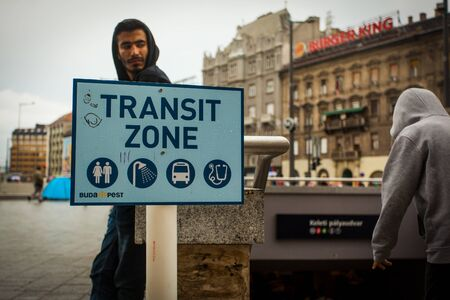 assad: BUDAPEST - SEPTEMBER 4 :Transit zone at the Keleti Railway Station for war refugees on 4 September 2015 in Budapest, Hungary. Refugees are arriving constantly to Hungary on the way to Germany.