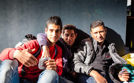 assad: BUDAPEST - SEPTEMBER 7: war refugees waiting for train at Keleti Railway Station on 7 September 2015 in Budapest, Hungary. Refugees are arriving constantly to Hungary on the way to Germany.