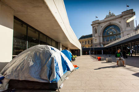 BUDAPEST - SEPTEMBER 7:  war refugees at Keleti Railway Station on 7 September 2015 in Budapest, Hungary. Refugees are arriving constantly to Hungary on the way to Germany.